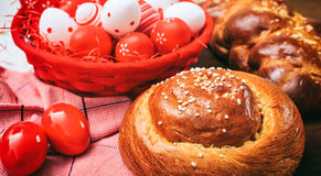 Easter traditional bread and eggs on wooden background Stock Photo