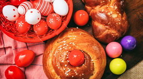 Easter traditional bread and eggs on wooden background Royalty Free Stock Photos