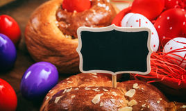 Easter traditional bread and eggs on wooden background Royalty Free Stock Images