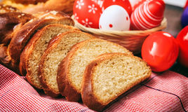 Easter traditional bread and eggs on wooden background Royalty Free Stock Photo