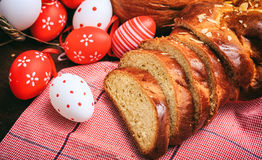 Easter traditional bread and eggs on wooden background Royalty Free Stock Photography