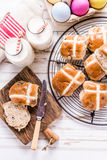 Easter traditional breakfast, hot cross bun and Easter eggs. Royalty Free Stock Photo
