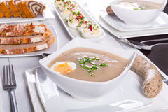 Easter traditional breakfast with white borsch soup. Eggs and sausages stock photos