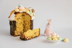 Easter traditional cake and pink bunny with colorful meringues. stock photos