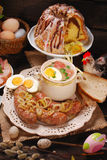 Easter traditional dishes on rural wooden table Stock Photos