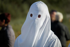 Easter traditional procession believer closeup behind shroud Stock Image