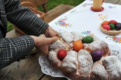 Colorful easter eggs and sweet bread. Easter traditions - colorful eggs placed in a traditional sweet bread Stock Photo