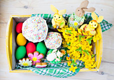 Easter tray. Easter plate with eggs, rabbits, Easter cakes and flowers Royalty Free Stock Photo