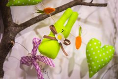 Easter tree decorated with soft toys in the form of rabbits of hearts and eggs royalty free stock photography