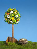 Easter tree flower arrangment. Blue sky and copy space Royalty Free Stock Image