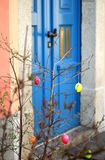 Easter tree. In front of the house with the blue door in Germany Royalty Free Stock Image
