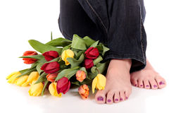 Easter tulips legs woman. Royalty Free Stock Photography