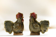 Easter two funny ceramic hens. Horizontal close up Royalty Free Stock Images