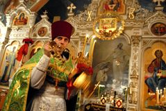 Easter in Ukraine. Priest ruled the service. Easter is the feast of Christ's resurrection, which in its observance combines both pagan and Christian elements Royalty Free Stock Photography