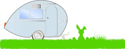 Easter vacation: easter bunny, eggs and caravan, Royalty Free Stock Images