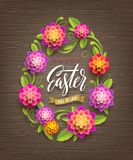 Easter vector illustration - Easter egg-shaped floral frame with greeting on a wooden background. Easter vector illustration - Easter egg-shaped floral frame Royalty Free Stock Photo