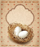 easter, vintage background with a nest and eggs Royalty Free Stock Images