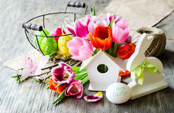 Easter vintage festive spring composition with flowers and baske Stock Photos