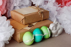 Easter vintage still life. Vintage still life with easter eggs and gift boxes in craft paper Stock Photos