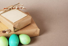 Easter vintage still life. Vintage still life with easter eggs and gift boxes in craft paper Royalty Free Stock Photo