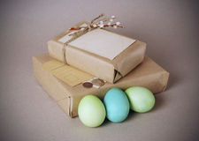 Easter vintage still life. Vintage still life with easter eggs and gift boxes in craft paper Stock Image