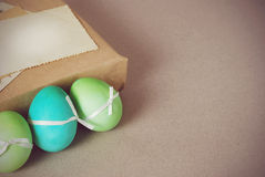 Easter vintage still life. Vintage still life with easter eggs and gift boxes in craft paper Stock Images