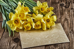 Easter Vintage Style yellow flowers with paper sheet Royalty Free Stock Photos