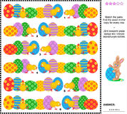 Easter visual riddle with rows of painted eggs and chicks. Easter themed visual logic puzzle: Match the pairs - find the exact mirrored copy for every row of Stock Image