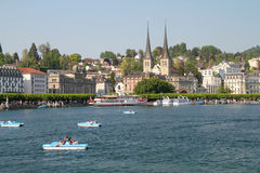 Easter week-end in Luzern. Luzern village is a relax place. You can take a cruise on Reuss river surrounded by Alp mountains or do some pedal boat on  Quatre Stock Photo