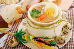 Easter white borscht with eggs and sausage in rural style Royalty Free Stock Image