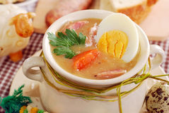 Easter white borscht with eggs and sausage in rural style Royalty Free Stock Photos