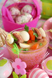 Easter white borscht with quail eggs and sausage in pink glass Stock Photography