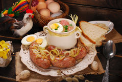 Easter white borscht and sausage on rural wooden table Royalty Free Stock Photography