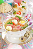 Easter white borsht with quil eggs and sausage Stock Photos
