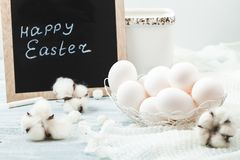 Easter white eggs on a light background Background for a postcard. Stock Photography