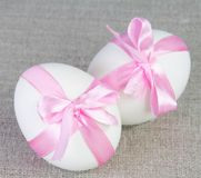 Easter White Eggs with Pink Bows on Sacking Stock Photography