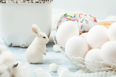 Easter white eggs and a rabbit on a light background Background for a postcard Royalty Free Stock Image