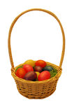 Easter wicker basket with colorful plastic eggs Royalty Free Stock Images