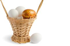 Easter wicker basket with eggs royalty free stock images