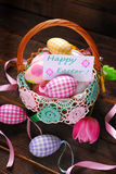 Easter wicker basket with eggs and greeting card Royalty Free Stock Photo