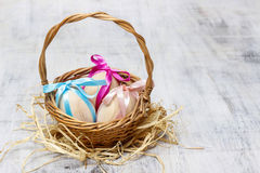 Easter wicker basket of eggs Royalty Free Stock Photo