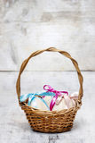 Easter wicker basket of eggs Stock Photo