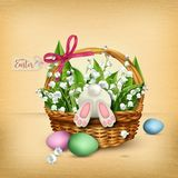 Easter wicker basket with rabbit and flowers Royalty Free Stock Photography