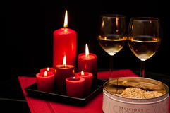 Cookies candles and wine Royalty Free Stock Photos