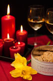 Cookies and wine with candles Stock Photos