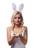 Easter Woman with Bunny Ears holding Colorful Eggs Stock Photography
