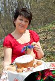 Easter. Woman with Easter cake Stock Photography