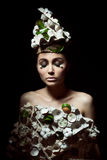 Easter woman with hat from carton box,  eggshells and flowers Stock Image