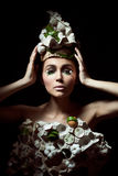 Easter woman with hat from carton box,  eggshells and flowers Stock Photography