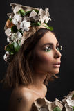 Easter woman with hat from carton box,  eggshells and flowers Royalty Free Stock Images